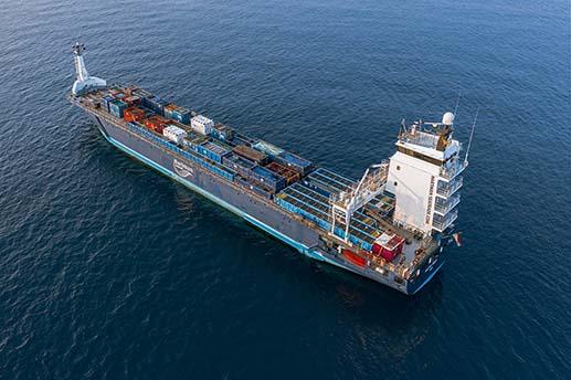 cargo ship, drone view, open ocean
